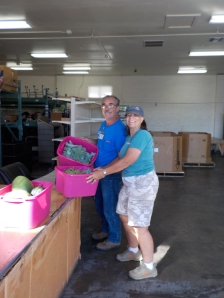 Robin Fox, representing PV Community Garden is making a Saturday morning drop off at the Yavapai Food Bank.